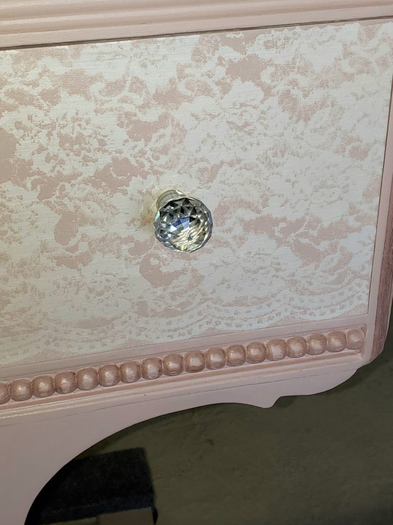 the lace stenciled drawer fronts popped with the fabulous hardware